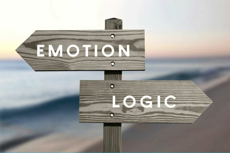 Wooden signpost with EMOTION and LOGIC in reference to emotional home buying