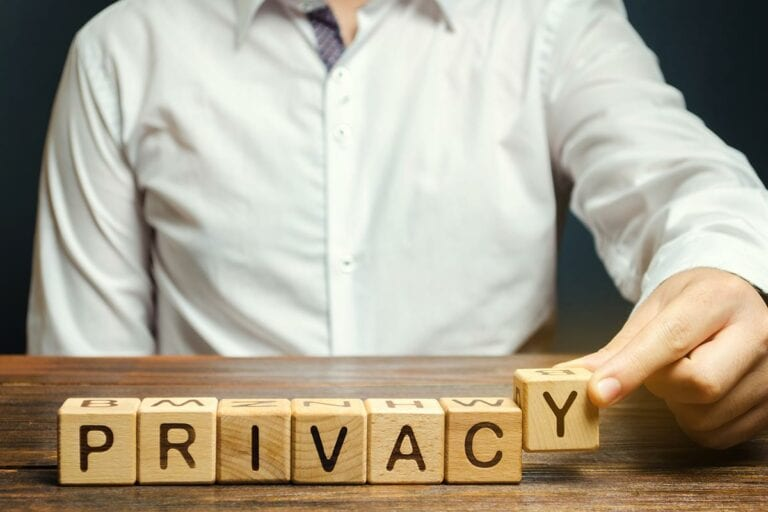 """Letter dice on table spelling out """"PRIVACY"""""""